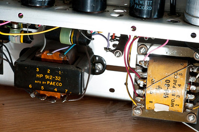 The transformer on the right is the mains transformer (highest voltage: 240VAC for plates, fed to the rectifier) whereas the transformer on the left is for output coupling into a 600-ohm load.