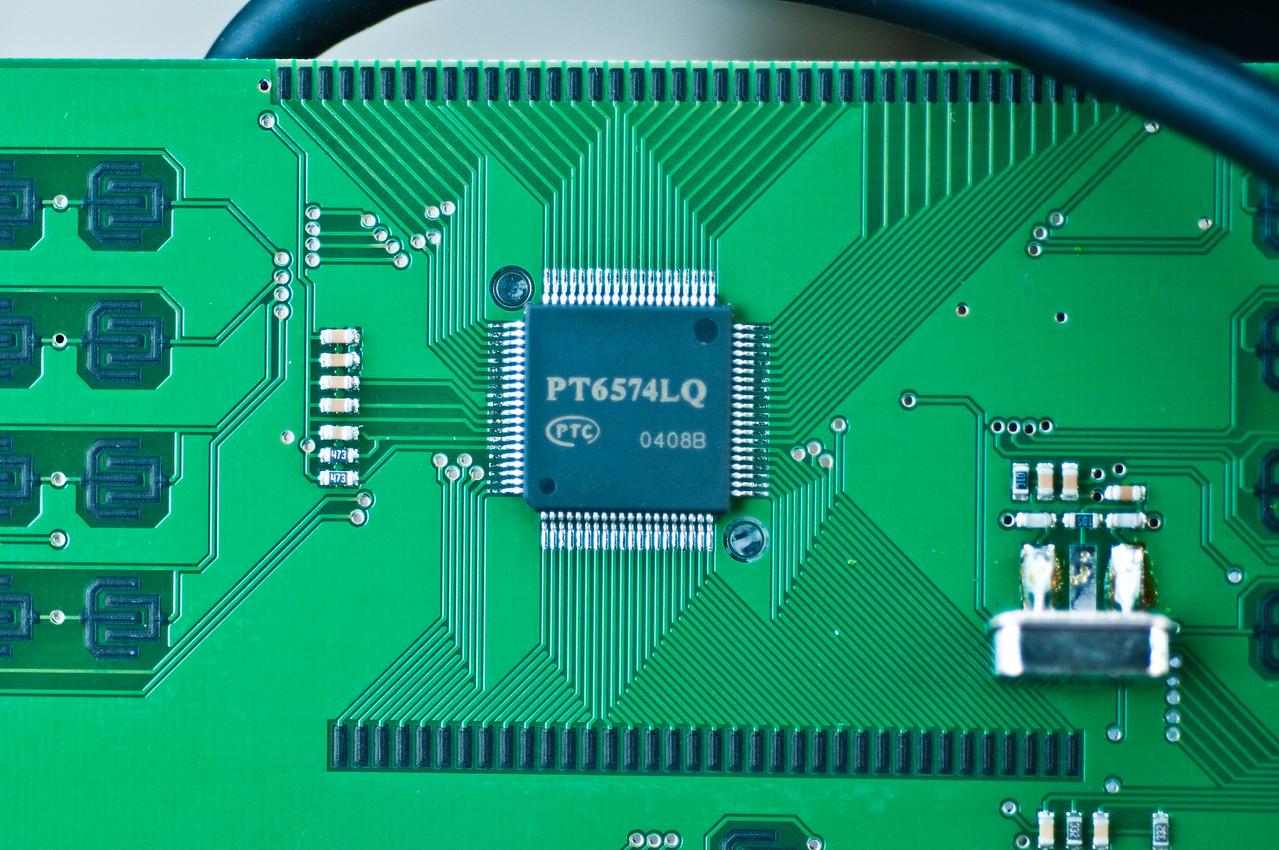 PTC PT6574LQ multisegment LCD driver underneath LCD. Note bizarre crystal mounting method...