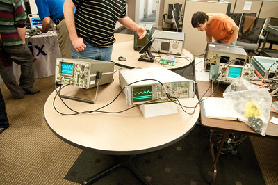 Tek's first digital oscilloscope flanked by an analog HP.