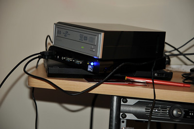 In a little precarious stack (X61 tablet dock / server / CD burner with OS disk); illustrates scale well.
