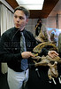 Argentinian paleontologists Juan Porfiri, investigator of Comahue University, shows to journalists, replicas of a dinosaur skeleton of what could be a new dinosaur species, a giant, plant-eater, uncovered in Argentina's Patagonia region, in Rio de Janeiro, Brazil, 15 October 2007. With a length of 32 meters, it is among the largest ever found, and is named 'Futalognkosaurus dukei' after the Mapuche Indian words for 'giant'.  The Patagonian dinosaur was uncovered on the banks of Lake Barreales in the Argentine province of Neuquen and according with the scientists the giant herbivore walked the Earth some 88 million years ago.  (Austral Foto/Renzo Gostoli)