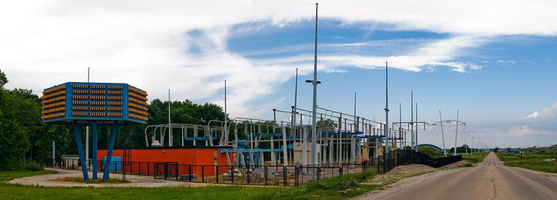 π-shaped power poles and a strange orange and blue thing that was almost certainly designed by Robert Wilson, at Fermilab.