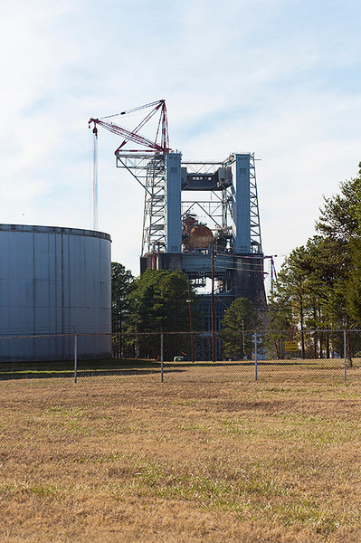 Saturn V rocket Test Stand 4670 with water tank from the test stand water deluge system, on the left, at the Marshall Space Flight Center