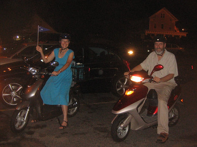 We rode our scooters to a party in downtown Holyoke, July 2006.  A warm night with light rain.