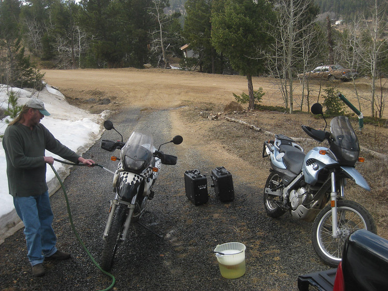 Gotta clean this mud before our mechanic sees our bikes!
