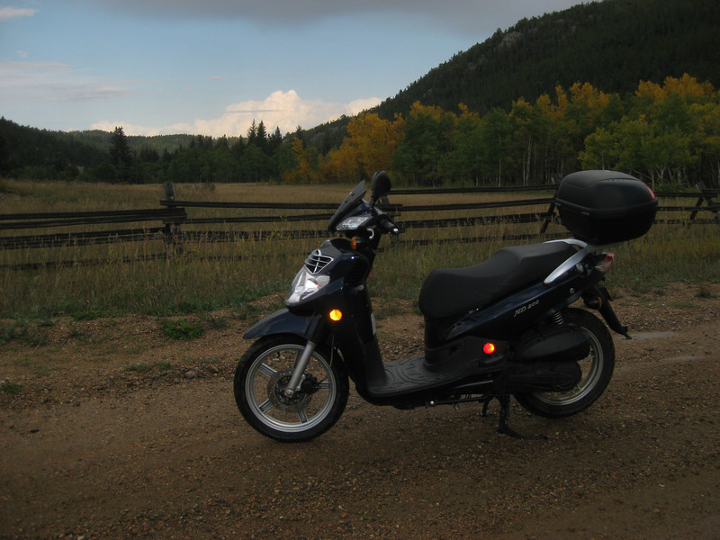 Early Fall colors w/ Ariel. Thunderhead in the background over Boulder.