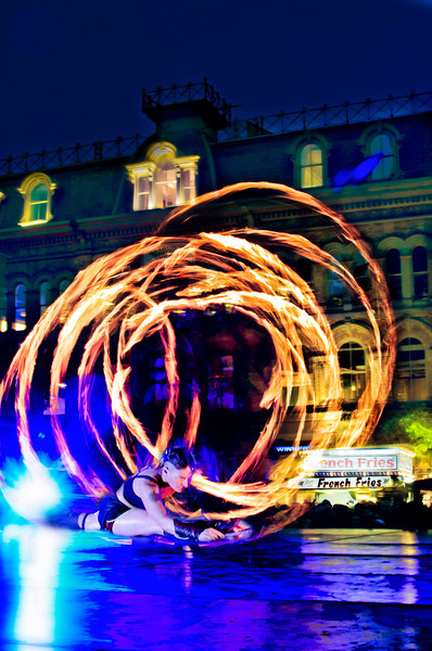 I caught this on 24 August, 2012 at Buskerfest in Toronto. That's Sophie McGrath of Dream State Circus during part of their fire act. It was cool, the people loved it.