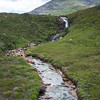 A waterfall leading to a river and a Loch