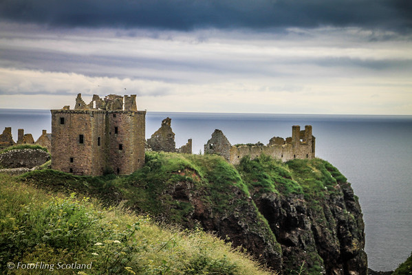 """Dunottar Castle Dunnottar Castle (Gaelic Dùn Fhoithear, """"fort on the shelving slope"""") is a ruined medieval fortress located upon a rocky headland about two miles south of Stonehaven. The surviving buildings are largely of the 15th–16th centuries, but the site is believed to have been an early fortress of the Dark Ages. Dunnottar played a strategic role in the history of Scotland from the Middle Ages through to the Enlightenment, because of its location.   More info Wikipedia."""