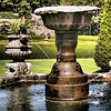 Fountain<br /> Pitmedden Garden is a garden in the town of Pitmedden, Aberdeenshire, Scotland owned by the National Trust for Scotland.<br /> <br /> The garden is noted for its geometric parterres which vary in shape from a thistle to Sir Alexander Seton's coat of arms. Pitmedden also has several long, varied borders which run along the garden walls. Sir Alexander Seton and Dame Margaret Lauder, his wife, established a house and garden at the site in 1675. The original garden was destroyed by fire in 1818.