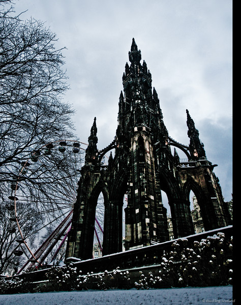 "Scott Monument<br /> The Scott Monument is a Victorian Gothic monument to Scottish author Sir Walter Scott (not to be confused with the National Monument). It stands in Princes Street Gardens in Edinburgh, opposite the Jenners department store on Princes Street and near to Edinburgh Waverley Railway Station.<br /> The tower is 200 feet 6 inches (61.11 m) high, and has a series of viewing decks reached by a series of narrow spiral staircases giving panoramic views of central Edinburgh and its surroundings. The highest viewing deck is reached by a total of 287 steps (those who climb the steps can obtain a certificate commemorating the event). It is built from Binnie shale quarried in nearby Livingston; the oil which continues to leech from its matrix has helped to glue the notoriously filthy atmosphere of Victorian Edinburgh (then nicknamed ""Auld Reekie"" — old smokey) to the tower, leaving it an unintended sooty-black colour. Bill Bryson has described it as looking like a ""gothic rocket ship""."