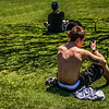 Tattoo Boy Texting in the Sun
