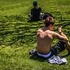 Tattoo Boy Texting in the Sun