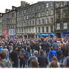 Edinburgh Festival crowd watches street performer
