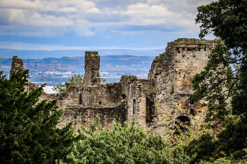 Aberdour Castle, Fife with Edinburgh across Firth of Forth in distance