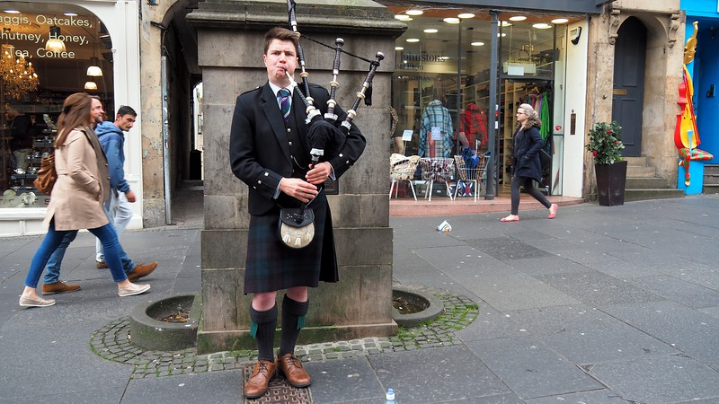 A man playing the bagpipes in Edinburgh, Scotland