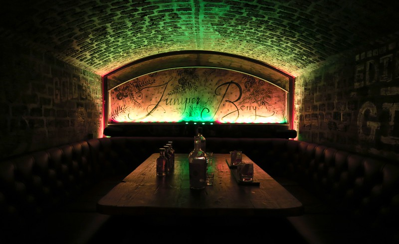 Dimly lit gin den at the Edinburgh Gin Distillery