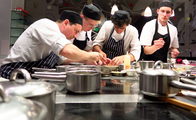 A busy kitchen scene in Edinburgh, Scotland