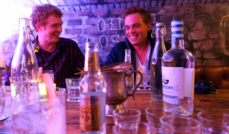 Sharing a laugh with my buddy Rob of Stop Having a Boring Life at the Edinburgh Gin Distillery Tour in Edinburgh, Scotland