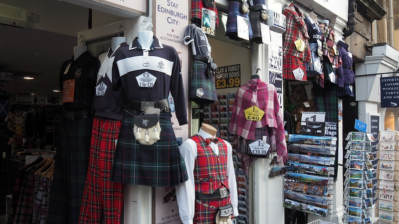Various souvenirs and kilts for sale along the Royal Mile in Edinburgh, Scotland