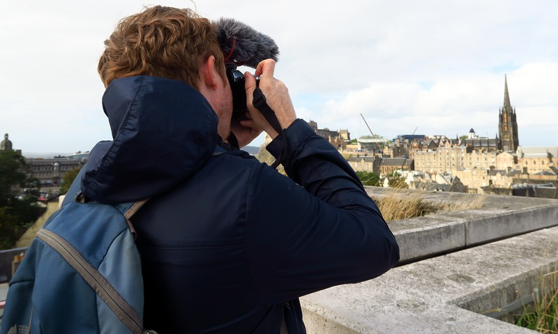 A shot of me taking some photos and video from a high vantage point in Edinburgh, Scotland