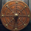Shield of embossed leather.