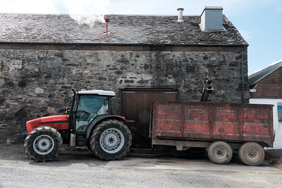 Farmer collecting spent barley (draff) at Kilchoman distillery, Islay