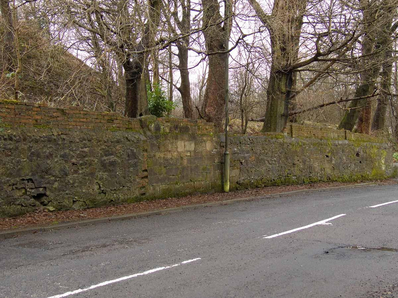 Wall at Auchenlodment Road, showing old entrance bricked up. Not sure what use it would have had as the area behind it is wooded.