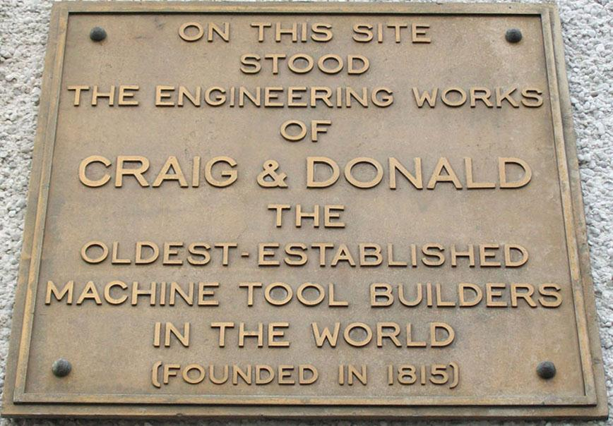 Sign on the side of Johnstone Baths, the site of Craig & Donald Machine Works