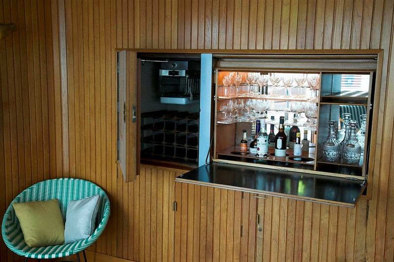 The drinks cabinet in the Sun Lounge (hidden behind a map in the wood panelling)