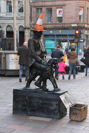 Glasgow Street Theatre with living statue of the Duke of Wellington complete with traffic cone in Buchanan Street. 3 January 2015