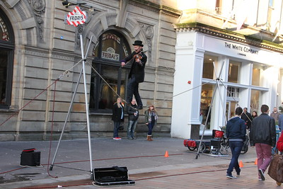 Glasgow Street Theatre with a violinist on a low wire. 3 January 2015