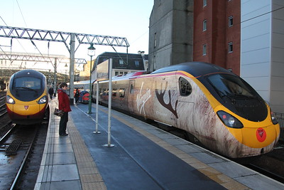 "Virgin Trains #Traindeer Pendolino 390 112 ""Virgin Star"" and friend at Glasgow Central. 3 January 2015"