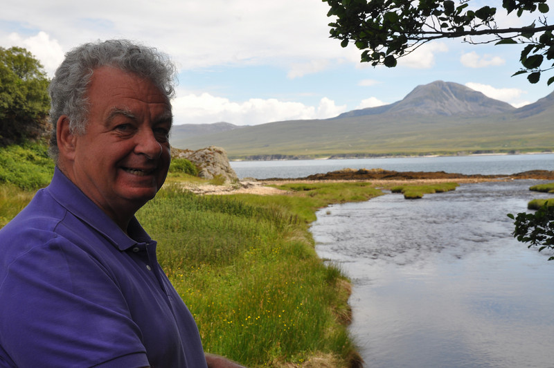 """Ian on the bridge at the burn near Bonahaven, Islay. With the Paps of Jura in the distance """"the burn"""" was Ian's favourite childhood playing place. Ashes to ashes from this bridge..."""