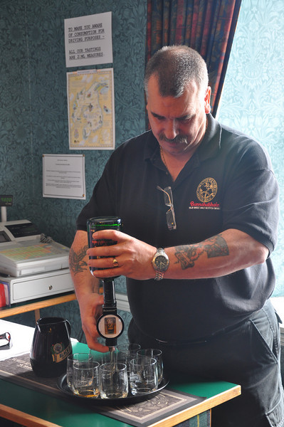 Our Bonahaven distillery guide pouring a few drams of beautifully smooth Bunnahabhain whisky for the visitors to enjoy. And while you're at the distillery shop don't forget to buy some wobbly whisky glasses too - they save drinking too much Bunnahabhain which could have the same effect
