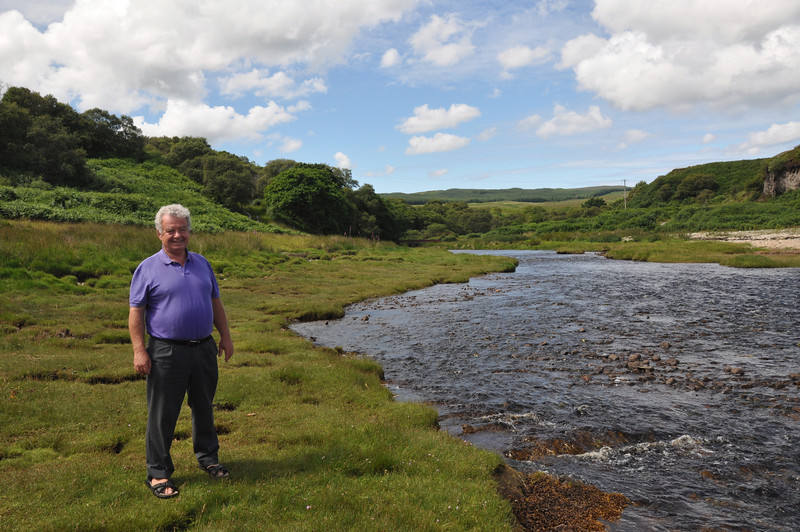 """Ian Goodall by the burn, near Bonahaven (Bunnahabhain), Isle of Islay. In the 1950s dams got built and rafts were launched at the entrance to """"the burn"""". The bridge, which used to be wooden, over the burn is further upstream and just visible in the distance. Ashes to ashes..."""