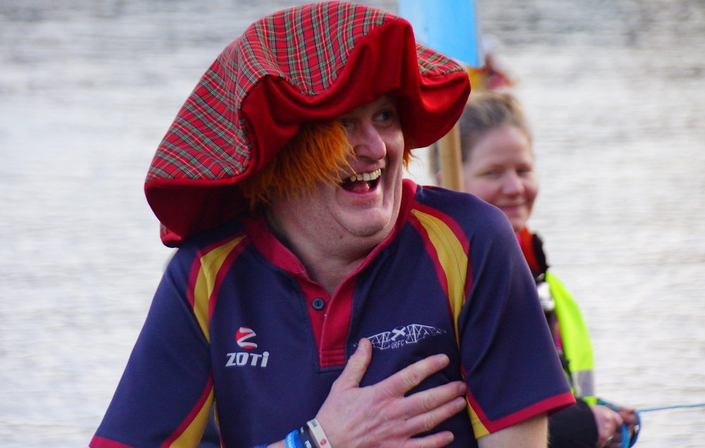 This man beams a radiant smiles during the Loony Dook festivities at the Firth of Forth.