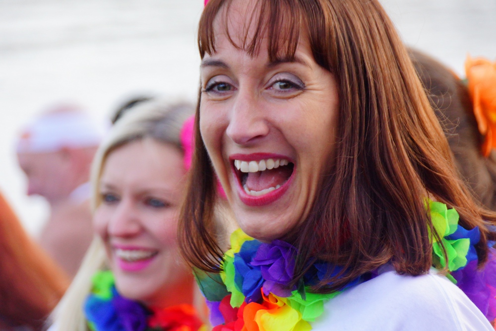 A delighted smile of a lady enjoying the Loony Dook in Scotland.
