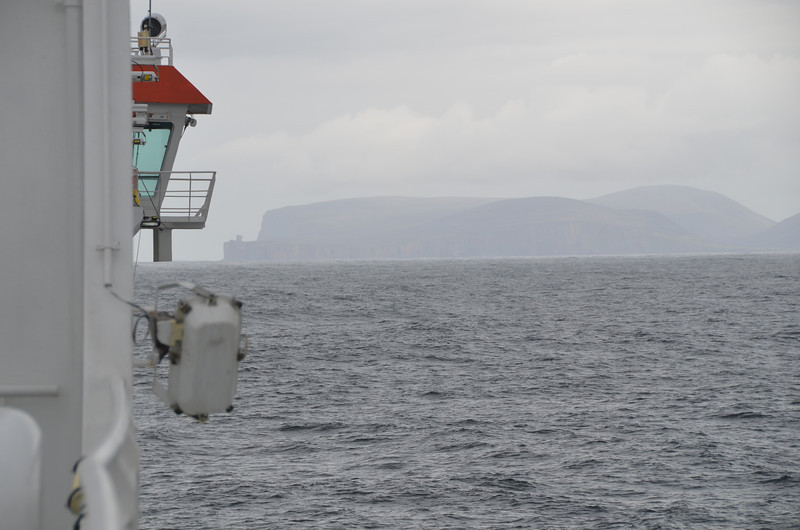 Orkney. As our ferry approaches the Island of Hoy we can just make out the outline of the Old Man of Hoy