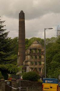 Looking down High Street, the remianing out buildings and Northern end of the mill, plus the mill's chimney. The remaining Northern end of the mill here was demolished soon afterwards.