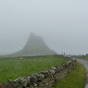 Lindisfarne Castle upon a foggy hill on Holy Island