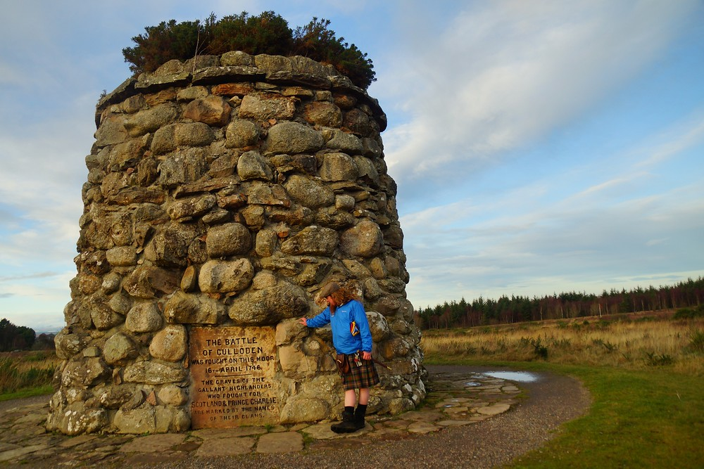 Dave standing beside the 6.1 meter Cairn Memorial