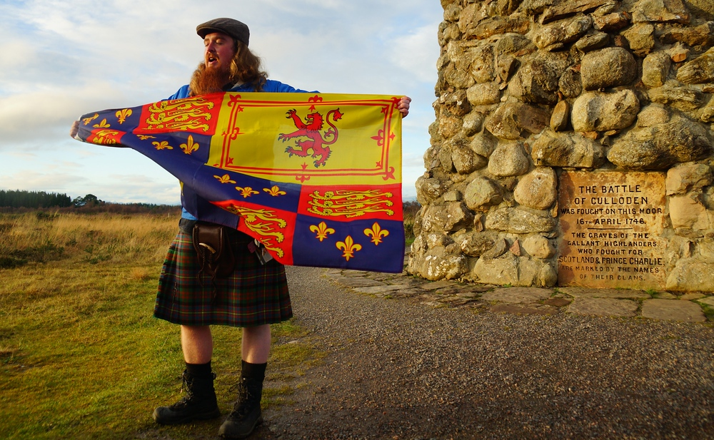 Dave sharing one of the many historical flags from his impressive collection