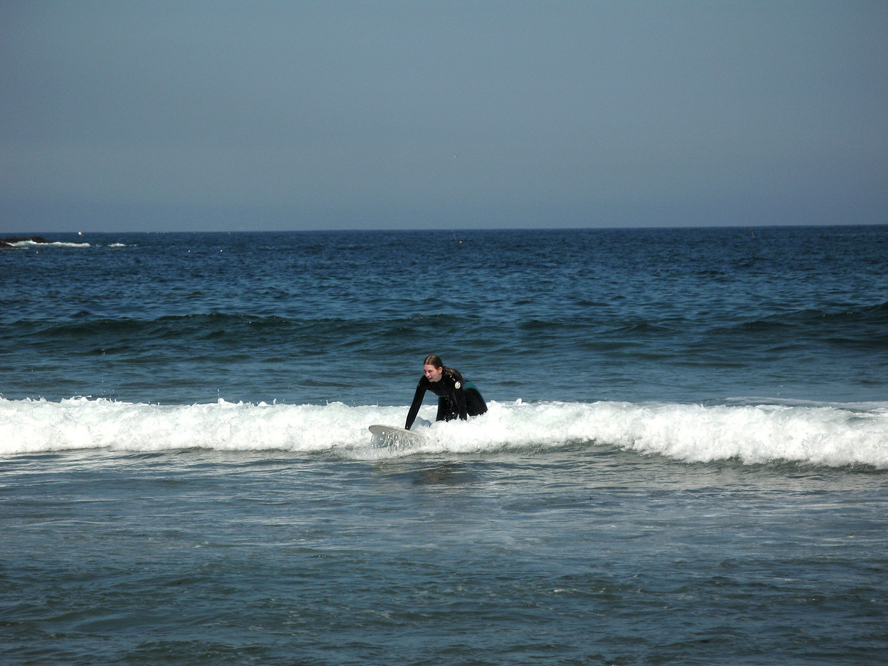 Becky sitting up on a wave