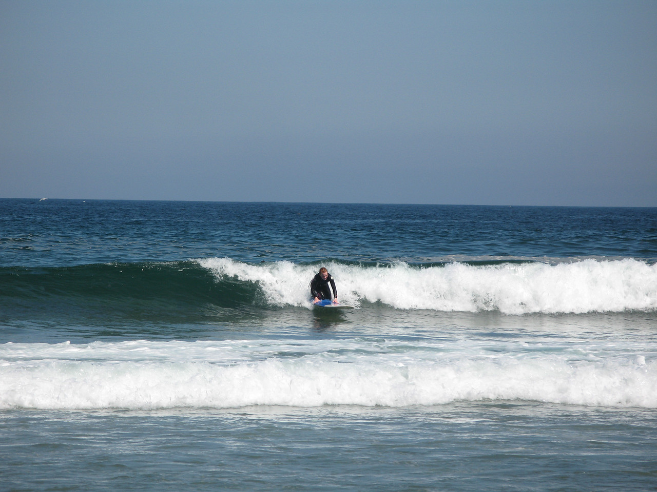 Vicky trying to catch another wave 1 of 4