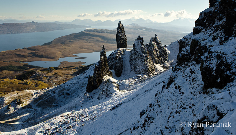 Photo:  A skiff of overnight snow on the rocky pinnacle named The Old Man of Storr.