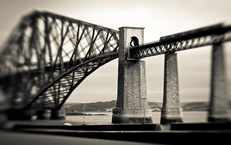 The Forth Bridge, a railroad bridge, over the Firth of Forth which has stood since 1890. It carries over 50,000 trains per year.  Its car-carrying nearby neighbor, The Forth Road Bridge, built in 1964, is soon to be torn down due to excessive deterioration.
