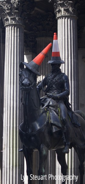 Glasgow - The Duke of Wellington statue has a traffic cone on his head for the past 30 years.  Cone was placed on his head and every time it was removed it was mysteriously replaced.  It recently was made permanent and is not removed