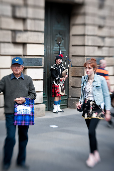 A brusker making a meager living along the Royal Mile that connects Holyroodhouse Palace to Edinburgh Castle.