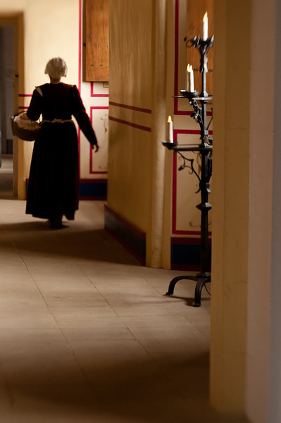 A chamber maid making her rounds.